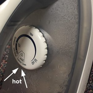 up close image showing how to set iron on high