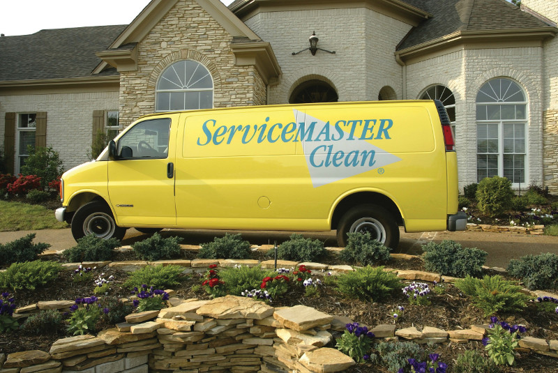 servicemaster clean van outside a home